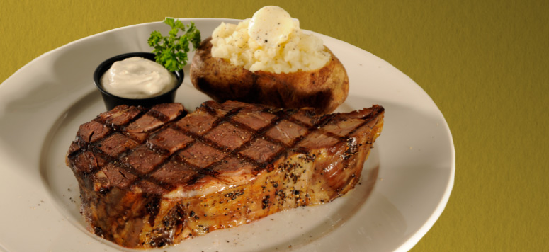 A generous cut of slow-roasted prime rib finished on a char grill for $7.77.