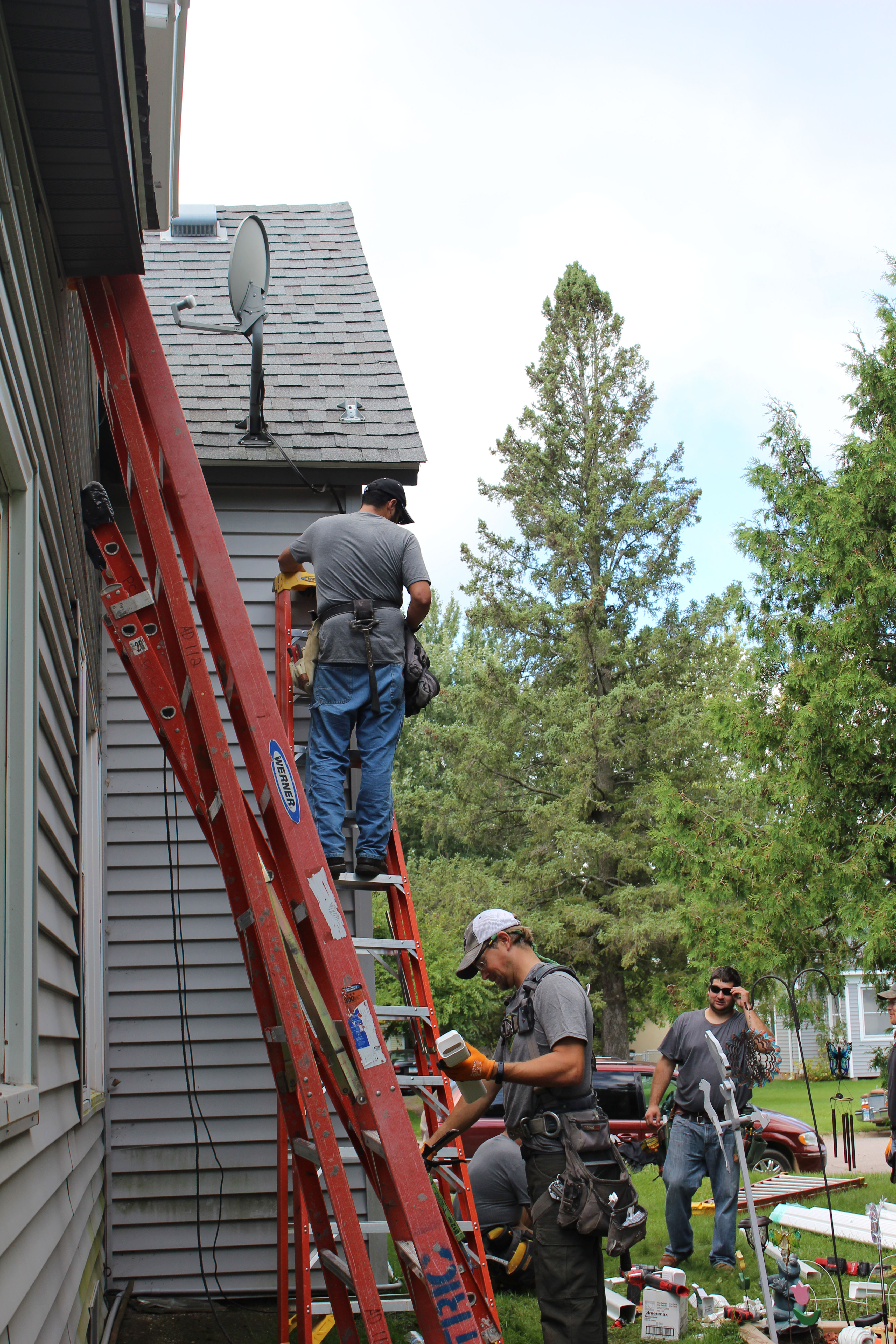 Our partner – PCL Construction – joins the event to install rain gutters on the entire house