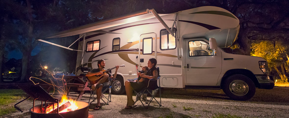 People by fire in RV park